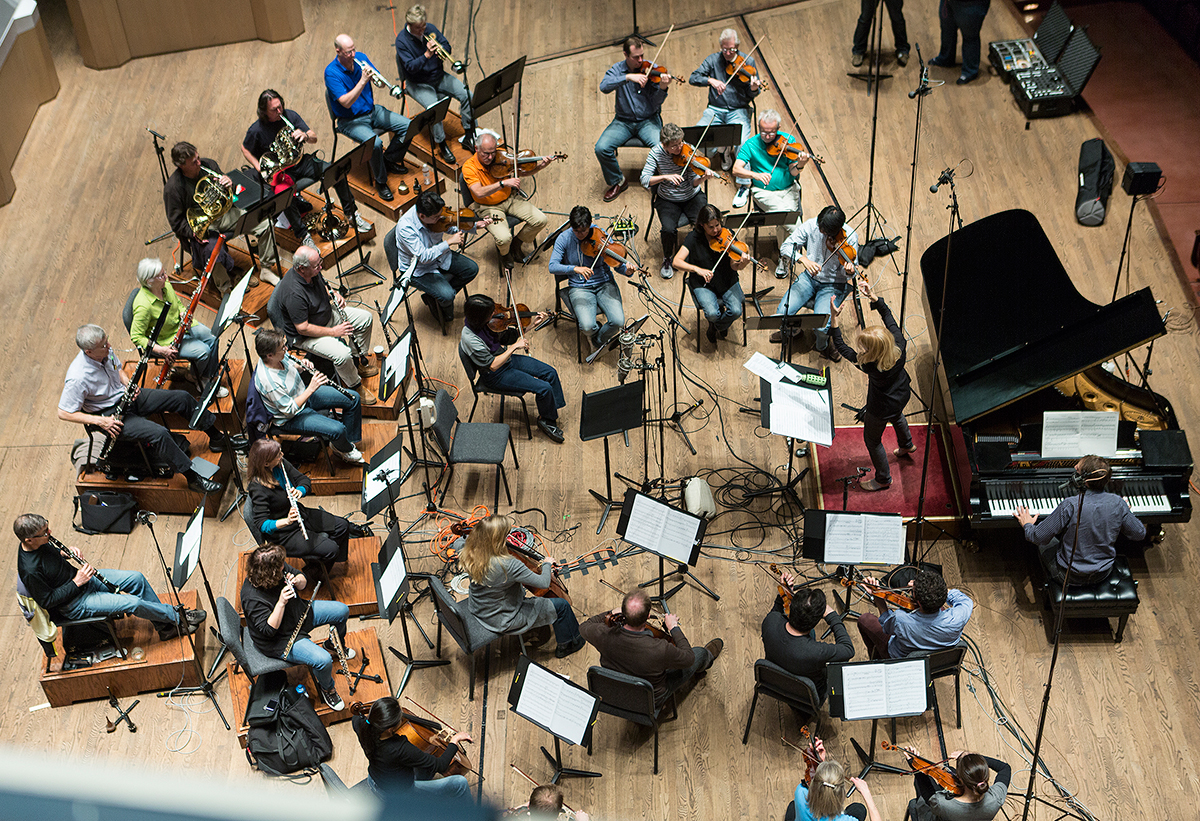 Aerial shot of the orchestra with Maria Schneider conducting